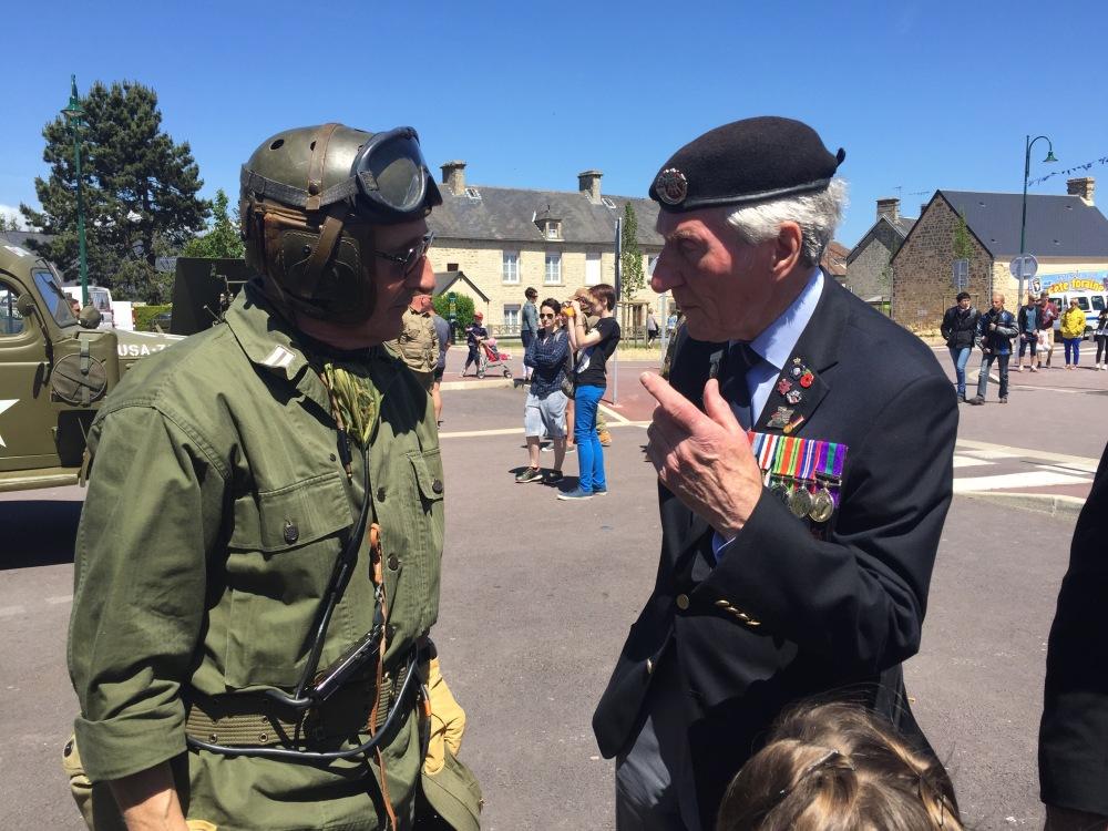 Veteran Ken Smith talking to WW2 re-enactor at Ste Mere Eglise.