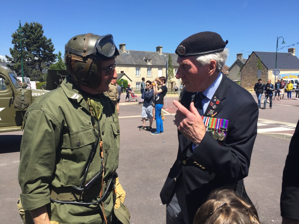Veteran Ken Smith talking to WW2 re-enactor at Ste Mere Eglise.