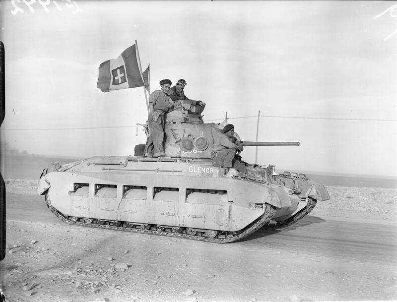 Imperial War Museum E1772: A British Matilda tank on its way into Tobruk, displaying an Italian flag, 24 January 1941.