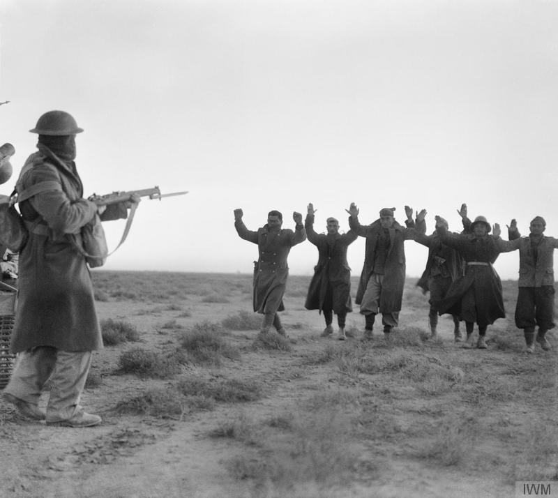 IWM E1580: Italian soldiers surrendering to an Australian infantryman during the attack on Bardia, Libya.